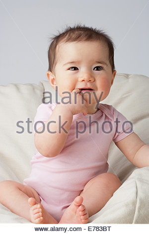 A baby in a beanbag chair - Stock Photo