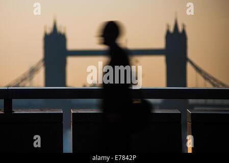 London, UK. 9th Sept, 2014. A commuter crosses London Bridge Credit:  Piero Cruciatti/Alamy Live News - Stock Photo