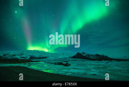 the Northern Lights (Aurora Borealis) over the Vatnajokull galcier and Fjallsarlon, eastern Iceland - Stock Photo