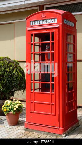 Red telephone box. - Stock Photo