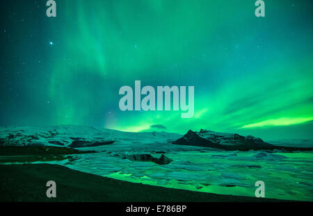 the Northern Lights (Aurora Borealis) over the Vatnajokull galcier and Fjallsarlon, eastern Iceland - Stock Photo