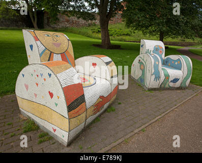 Street art, seating in public park, two arm chairs created with colourful mosaic tiles & smiling face design, Carlisle, - Stock Photo