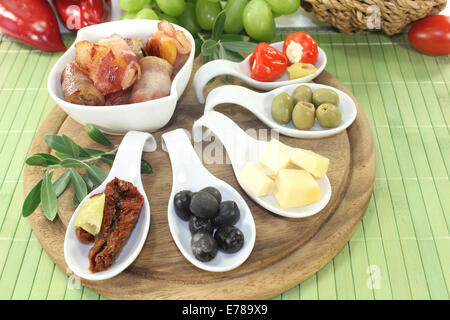 Tapas stuffed with prunes, figs, apricots and bacon - Stock Photo