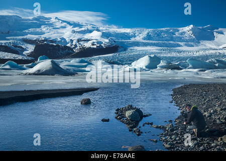 the Vatnajokull Glalcier decending to sea level at Fjallsarlon, eastern Iceland - Stock Photo