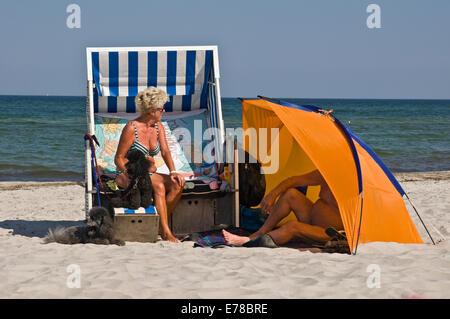 Elderly couple enjoying sunshine on the beach in Prerow, Baltic coast, Germany - Stock Photo