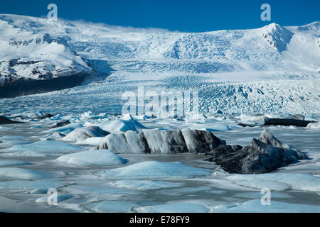 the Vatnajokull Glacier decending to sea level at Fjallsarlon, eastern Iceland - Stock Photo