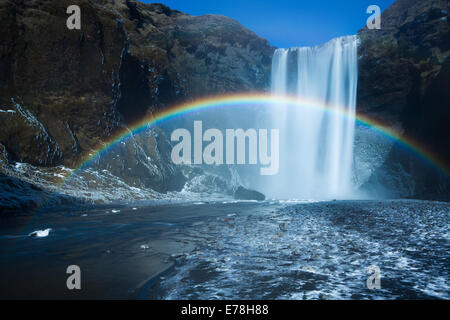 a rainbow at Skógafoss, southern Iceland - Stock Photo