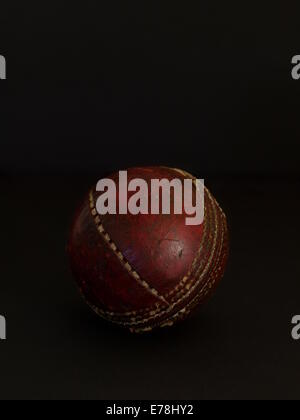 Cricket ball on black background - Stock Photo