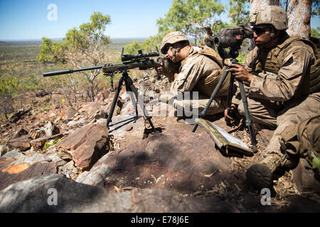 U.S. Marine Corps Cpl. Cruz A. Nunez, right, a scout sniper with Scout Sniper Platoon, 1st Battalion, 5th Marine - Stock Photo