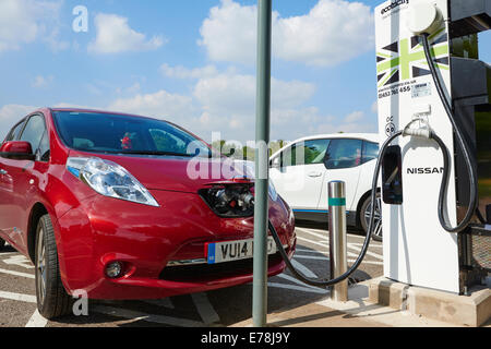Nissan Leaf Electric Car Being Charged In The Car Park At Corley Services Warwickshire UK - Stock Photo