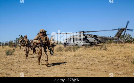 U.S. Marines with Bravo Company, 1st Battalion, 5th Marine Regiment conduct a helicopter insert during a live-fire - Stock Photo