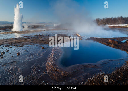 the hot springs and geysers at Geysir, Iceland - Stock Photo
