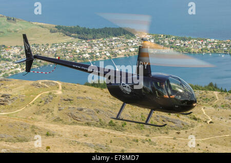 Robinson R44 helicopter in flight - Stock Photo