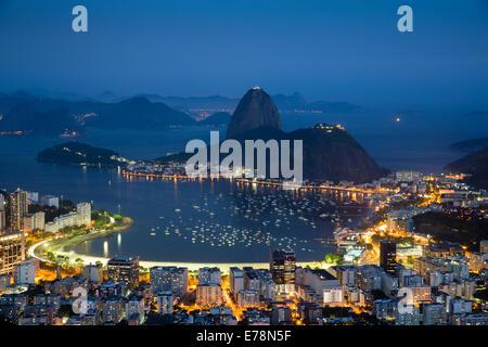the bay, city and Sugar Loaf Mountain at dusk, Rio de Janeiro, Brazil - Stock Photo