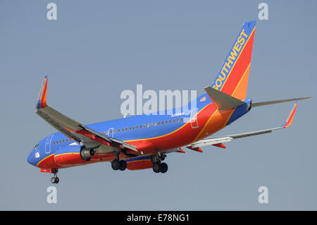 Boeing 737-700 of Southwest Airlines on final approach to Los Angeles International Airport - Stock Photo