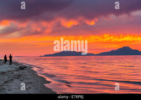 Sunset over sea in Greece - Stock Photo