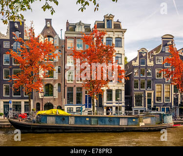 Buildings on canal in Amsterdam - Stock Photo