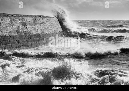storm waves breaking over the Cobb at Lyme Regis, Jurassic Coast, Dorset, England. - Stock Photo