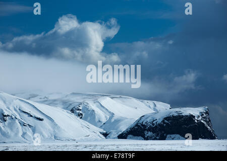 Harfursey in the snow, Myrdalssandur, southern Iceland - Stock Photo