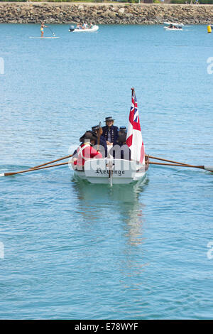 Performers dressed as British sailors in a long boat entertain crowds at the Toshiba Tall Ships Festival Dana Point - Stock Photo