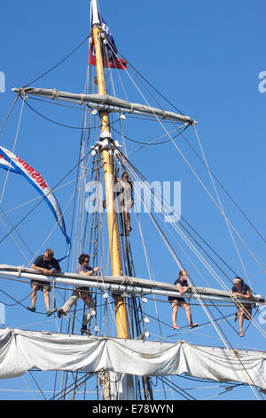 Crew members of the brigantine Exy Johnson tend to the rigging & sails at the Toshiba Tall Ships Festival Dana Point - Stock Photo