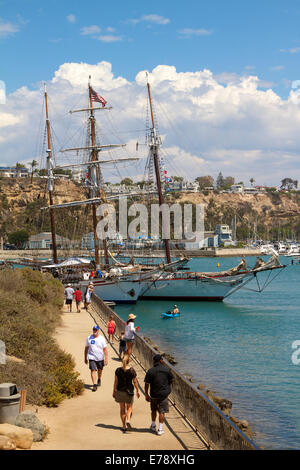 Visitors walking along the shore at 30th Annual Toshiba Tall Ships Festival in Dana Point Harbor Southern California - Stock Photo