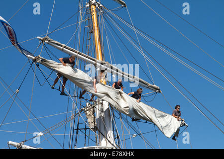 Crew members fixing the sails brigantine Exy Johnson at the 30th Annual Toshiba Tall Ships Festival Dana Point Harbor - Stock Photo