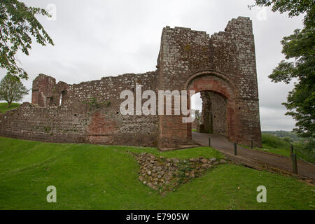 Ruins of historic Egremont castle, imposing red stone entranceway and high walls on hilltop above town in Cumbria, - Stock Photo