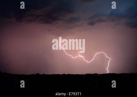 lightning bolt in night sky over the horizon