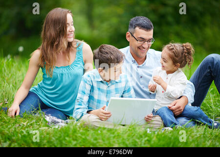 Happy family members spending time in the park - Stock Photo