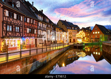 Christmas decoration by night at the Little Venice. Colmar. Wine route. Haut-Rhin. Alsace. France. - Stock Photo
