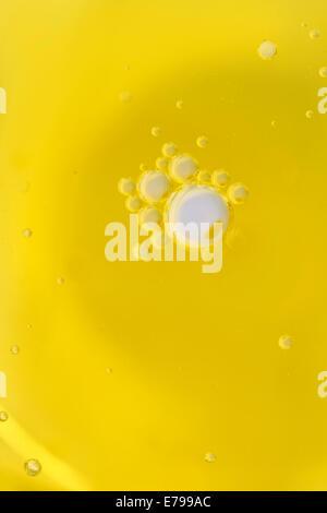 bubbles droplets drops circles olive oil - Stock Photo