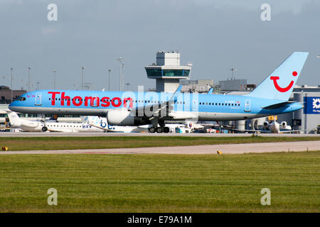Thomson Airways Boeing 757-200 touches down on runway 23R at Manchester airport. - Stock Photo