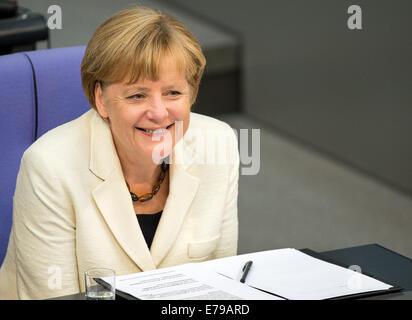 Berlin, Germany. 10th Sep, 2014. German Chancellor Angela Merkel (CDU) sits in the German Bundestag in Berlin, Germany, - Stock Photo