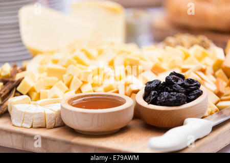 Cheese Plate with Dried Fruit and Honey - Stock Photo