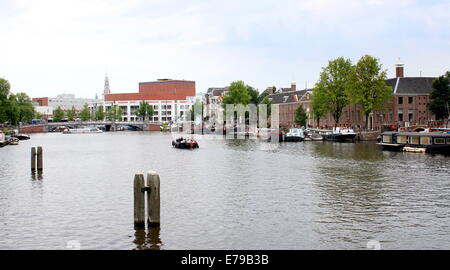 Hermitage Museum at Amstel river bank in the Dutch capital Amsterdam, in the background the Stopera Opera House - Stock Photo