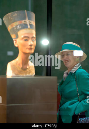 Berlin, Germany. 10th Sep, 2014. Queen Margrethe II of Denmark looks at the bust of Nerfertiti at the New Museum - Stock Photo