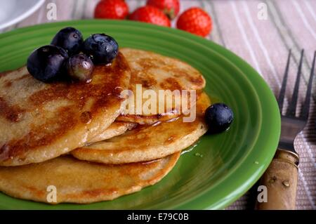Breakfast table with pancakes and blueberry. closeup - Stock Photo