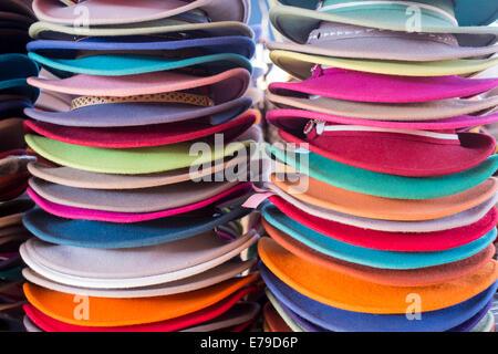 Stacks of colourful felt hats, black market, Mörön, Mongolia - Stock Photo