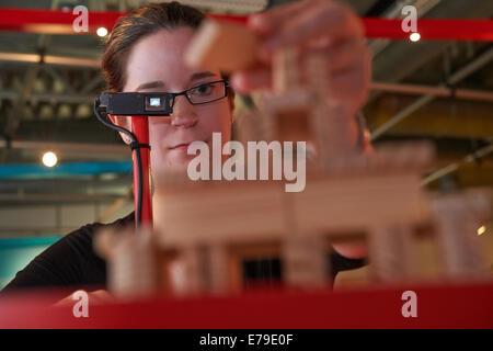 Dortmund, Germany. 10th Sep, 2014. DASA employee Jana Rech looks through data glasses showing a construction plan - Stock Photo