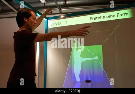 Dortmund, Germany. 10th Sep, 2014. DASA employee Daniel Nolle demonstrates the functioning of the 'Digital Ergonomy' - Stock Photo