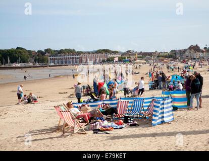 Holidaymakers enjoying sunshine on the sandy beach at Weymouth, Dorset, England - Stock Photo