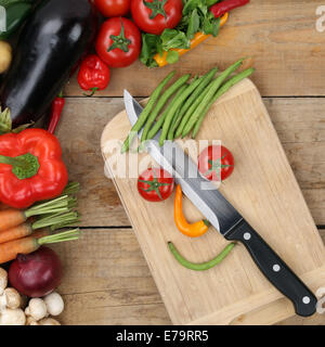 Healthy eating preparing food smiling vegetables face on cutting board - Stock Photo