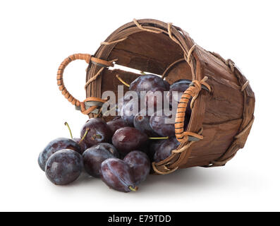 Plums in a basket isolated on white - Stock Photo