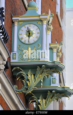 Ornate clocks above the main entrance to Fortnum & Mason shop in Piccadilly, London, England - Stock Photo