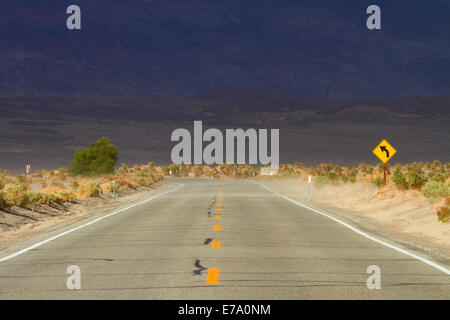 Sand blowing across the road near Stovepipe Wells, Death Valley National Park, Mojave Desert, California, USA Stock Photo