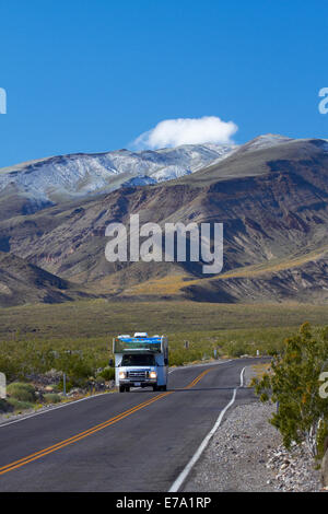 RV on road coming over Panamint Range into Death Valley, Death Valley National Park, Mojave Desert, California, - Stock Photo