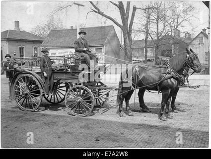 Firemen on Kawanee #1 Horse-Drawn Fire Engine, Kawanee, Illinois , USA, 1905 - Stock Photo