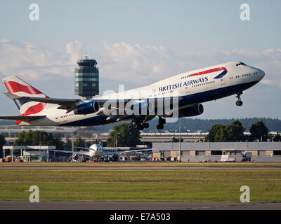 A British Airways Boeing 747-400 (G-BNLU) wide-body jumbo jet takes off from Vancouver International Airport, Canada - Stock Photo