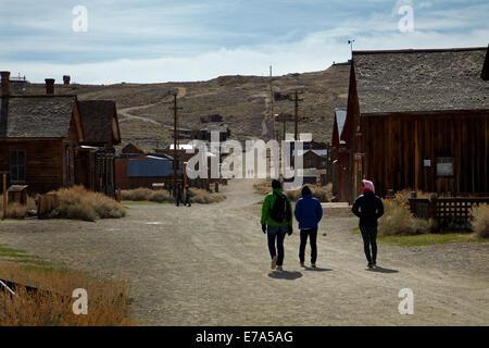 Tourists, Green Street, Bodie Ghost Town, Bodie Hills, Mono County, Eastern Sierra, California, USA - Stock Photo